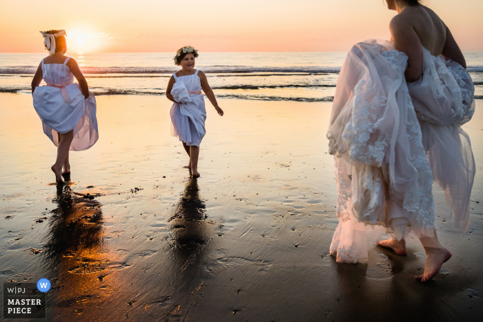 Del Mar, Ca Wedding Photographer \ Flower girls and bride are enjoying sunset on the beach before the reception