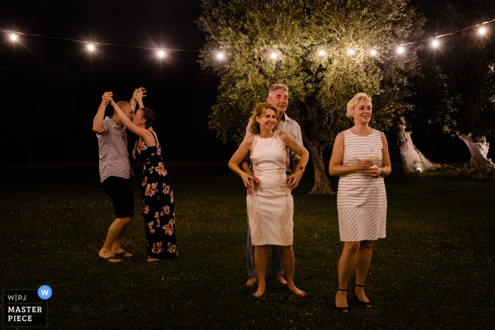 Puglia wedding photography from an outdoor reception at night under lights