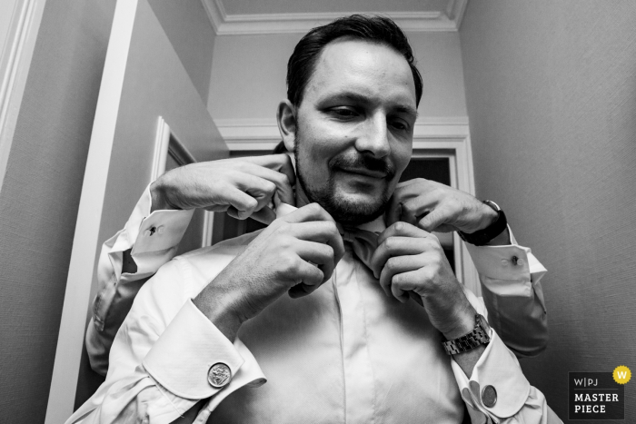 Vaalsbroek Photography of a Groom getting Tie put on at a Wedding in Aachen