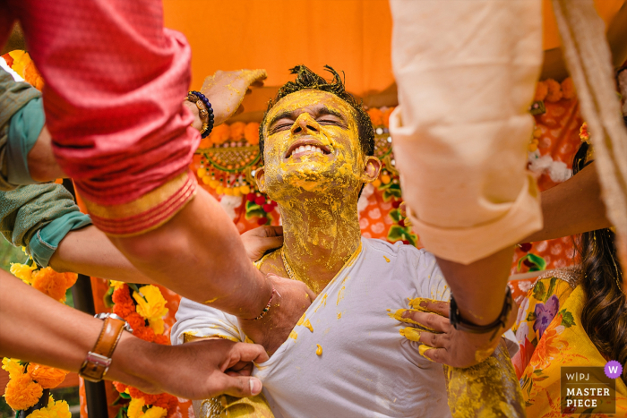 Maryland Pictures   Pre-Wedding Ceremony pictures at brides home - Haldi being put on the groom before his wedding