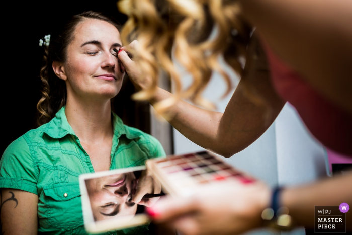 Váňův Statek wedding preparations of the bride having her make-up done before the ceremony