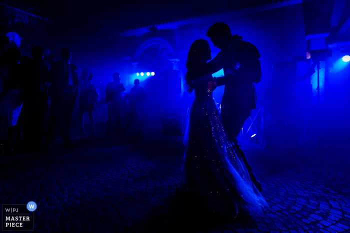 Castello di Torcrescenza Roma Nord, Italy wedding photography of The silhouette of the bride and the groom having their first dance as newly wed.