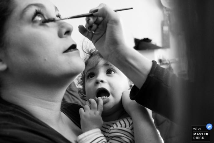 Casa de la Novia wedding preparations - daughter watching as her mother's make-up is done.