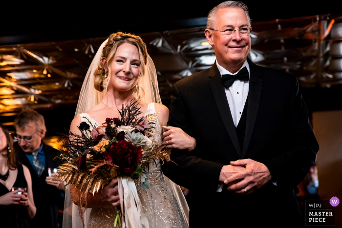 Ironworks (Denver, CO) wedding venue photographer: Bride walking down the aisle with her father