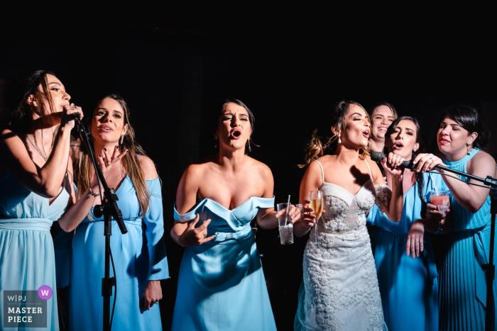Ilheus - BA - Brazil wedding photograph image - Bridesmaids in blue dresses Singing in one voice.