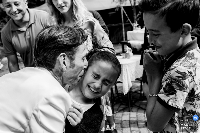Netherlands Wedding Reception Photography with Kids   This girl didn't want to have a kiss from her uncle the groom