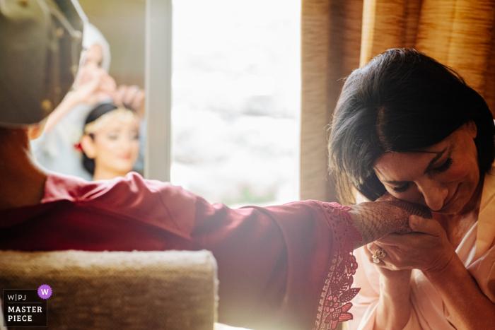 Omni Barton Creek Austin Texas wedding venue photographer: Mother cries clutching brides hand as she readies for her south asian wedding