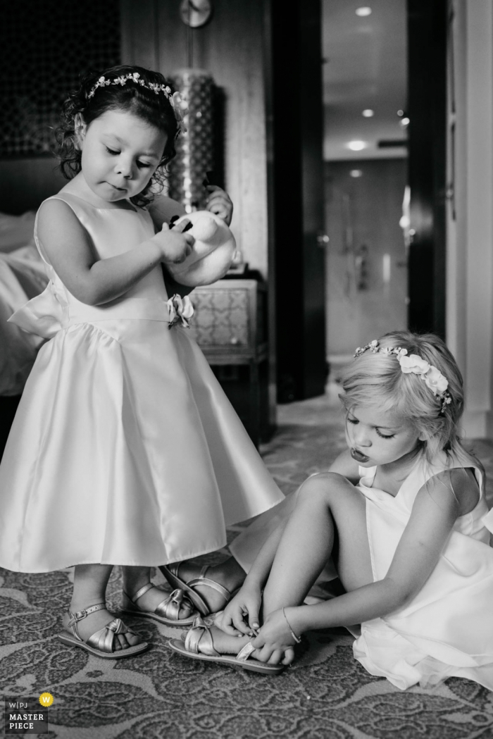 Photos of Chatty Flowergirls getting dressed at the The Ritz Dubai on wedding day.