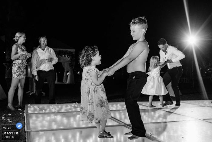 The Ritz Dubai wedding venue photos from night event | Young cute couple dancing