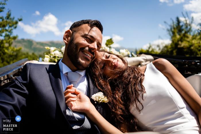 Abruzzo, Pettorano Sul Gizio - photographer rides in convertible car with the bride and groom