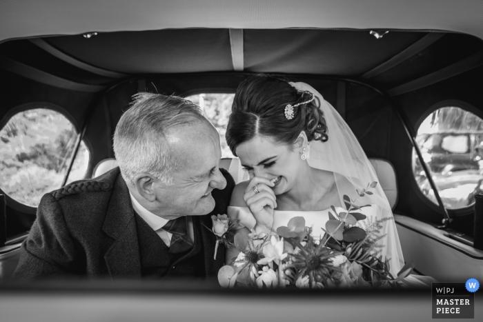Scotland Wedding Auto Ride Photography   Bride & father arrive in the wedding car.