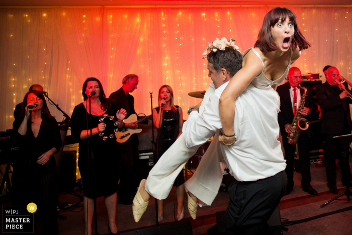 Hensol Castle wedding venue reception photography of Dancing with the band behind them
