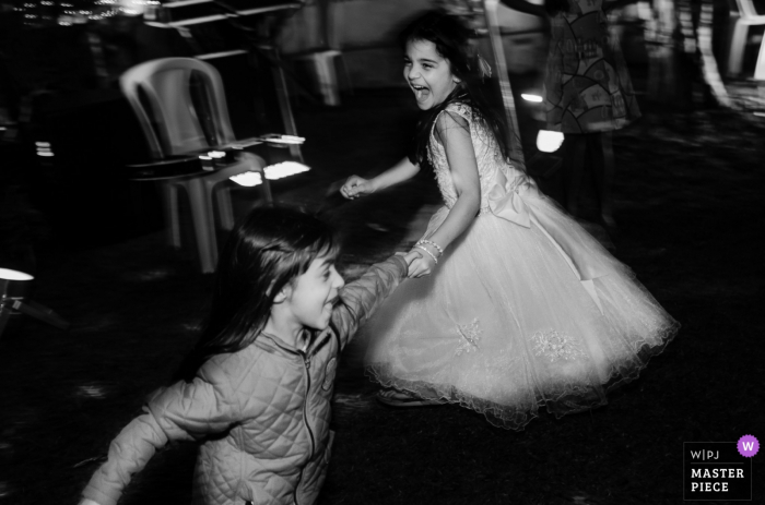 Brazil Wedding Reception Venue Photography | Little bridesmaid and her friend playing and dacing during party