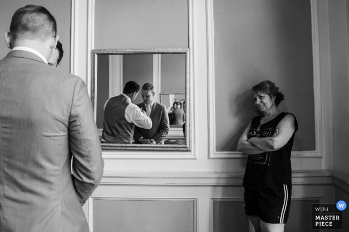 Greysolon Ballroom wedding venue photos | Mom watching Groom getting help in the mirror