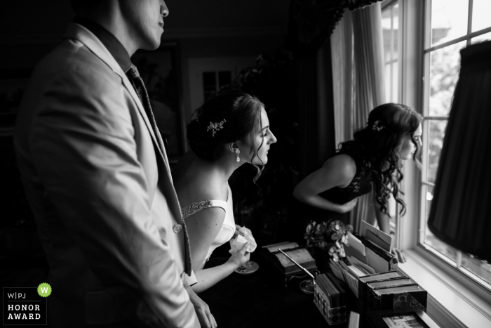 Private residence wedding photography at Saratoga | One last peek out the window