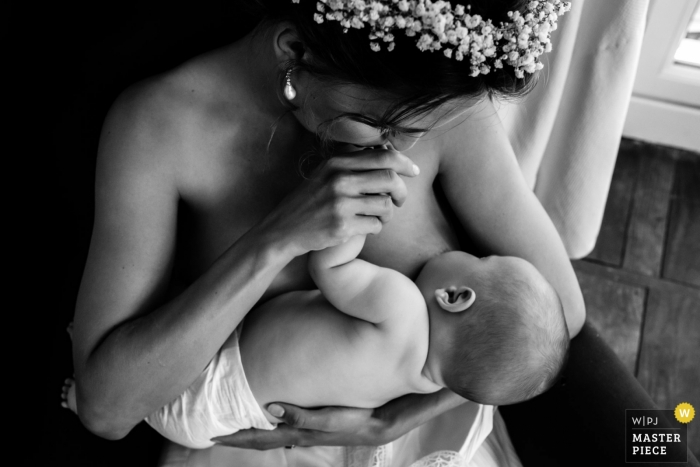 Nouvelle-Aquitaine reception venue photo of a suspended moment... bride but also mother breastfeeding her baby