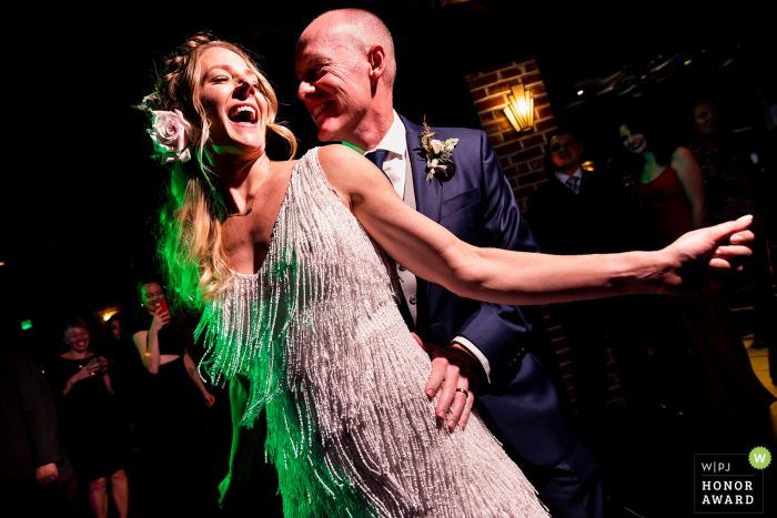 Photography at the Wedding Venue : Ironworks (Denver, CO) - Bride and groom cutting a rug during the dance party.