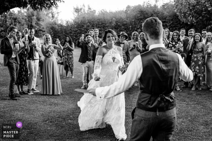 Mas de Peint, Camargue, France photography from a wedding - the bride will kiss her husband after his speech