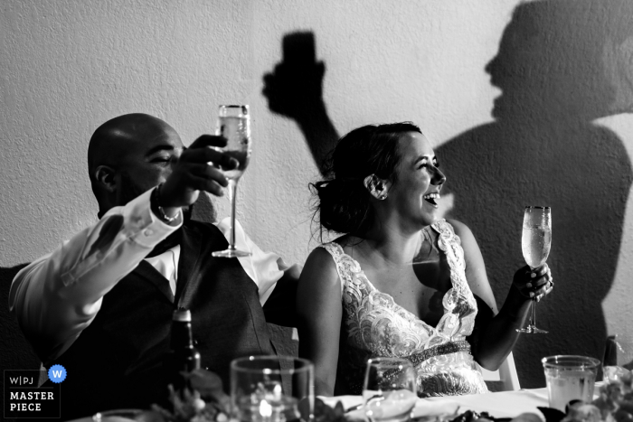 The Golf Club of Texas wedding venue pictures | Maid of Honor Toast with shadow on the wall behind the bride and groom