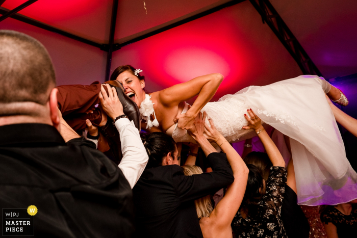 Château La Forêt - The bride is carried overhead while holding onto her dress