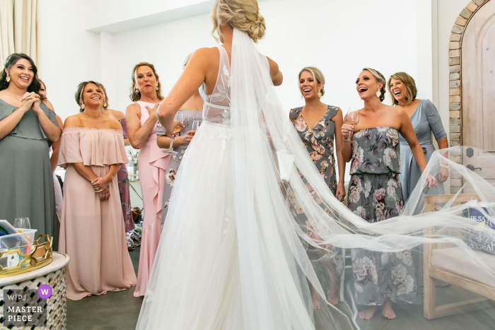 Wedding photography from Wrightsville Manor, Wrightville, SC | Bridesmaids and Mom react to wedding dress reveal