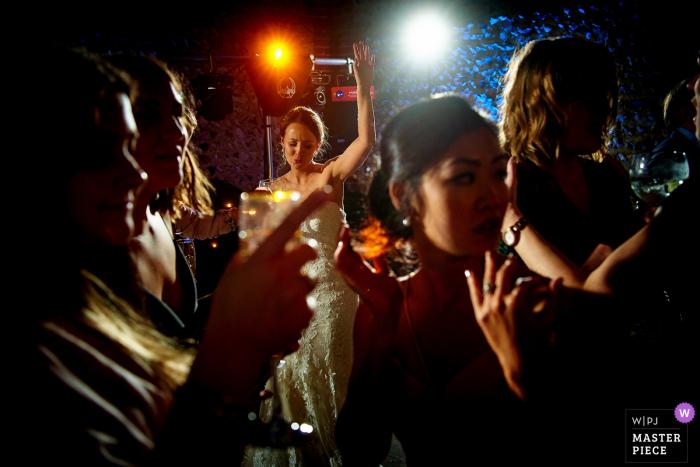 Cissbury Barns, West Sussex, UK Bride on the dance floor - Wedding Reportage Photographer
