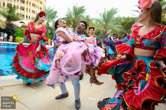 Wedding celebration photography at Ras Al Khaimah, UAE - The groom loved lifting up his mother as a growing boy and now when he is getting married, his favourite thing to do is to lift his bride up and dance with her!