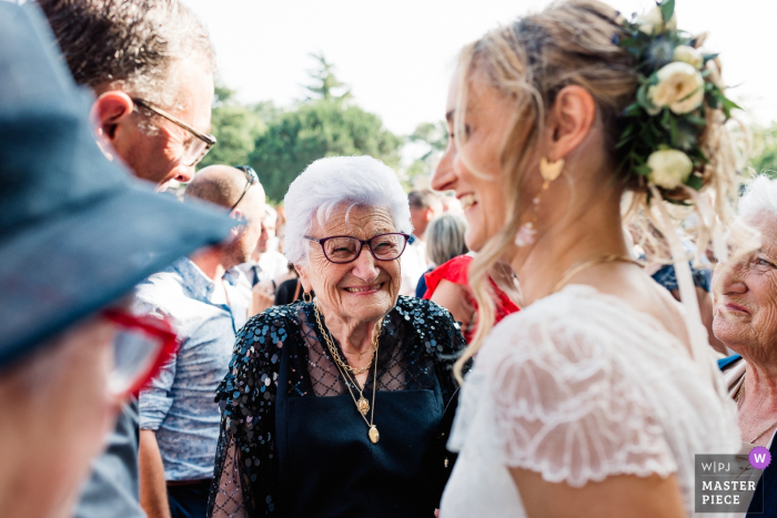 Church in Simacourbes, France wedding photo showing the happiness of the grandmother
