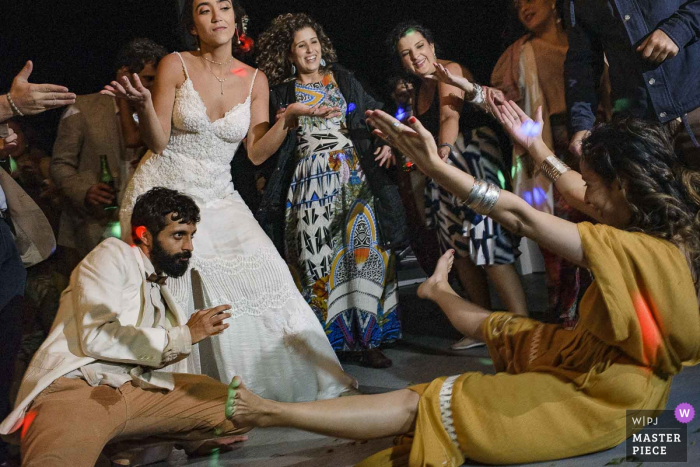 Wedding photography on a boat in Paraty, Rio de Janeiro, Brazil - Guests go crazy on the dance floor