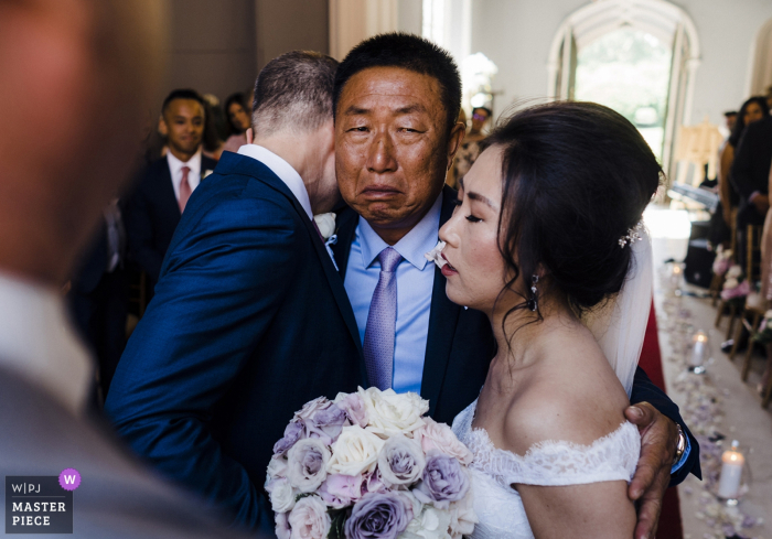 Wedding Photography at Venue - Luttrelstown Castle Co Dublin Ireland | Emotional father of the groom giving his daughter away