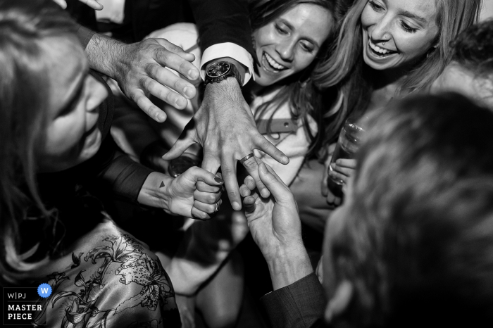 Resort at Squaw Creek, Squaw Valley, CA Wedding Photographer: Guests admire the groom's new ring on the dance floor.