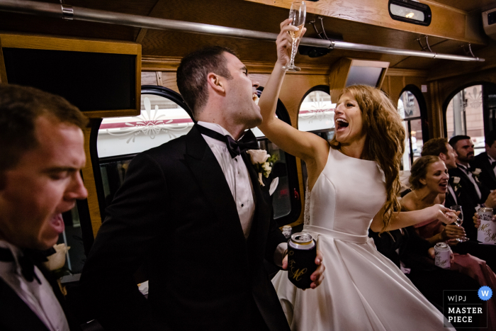 Illinois bridal party in bus | Wedding picture of the bride and groom in the bus