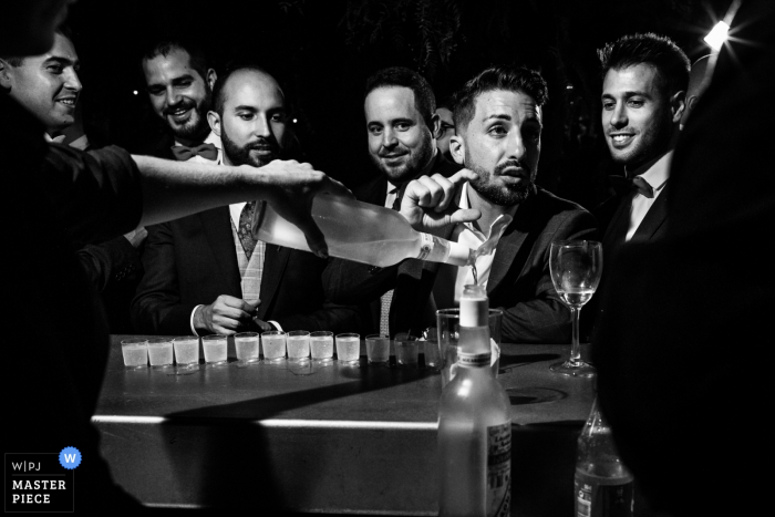 Spain Wedding Venue Picture of the groom and his friends with shots