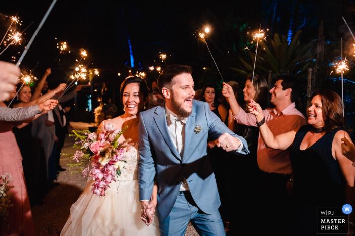 Solar da Palmeiras - Ilha da Gigóia/RJ - Brazil wedding photographer: Its time to shine under the sparkler exit