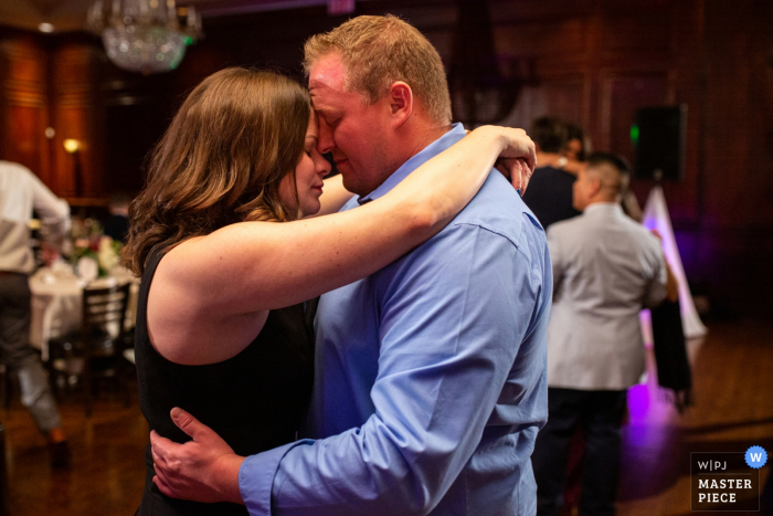 Maggiano's River North, Chicago, IL Wedding venue photography   Quiet moment between a couple on the dance floor at a wedding at Maggiano's River North.