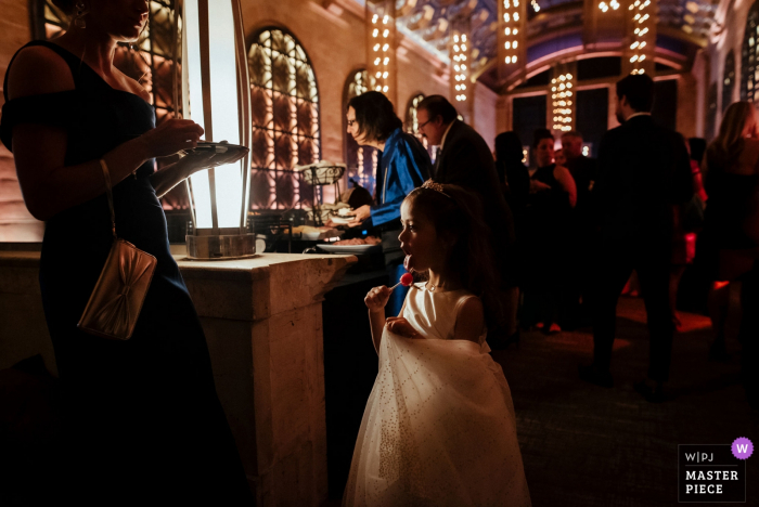 Reception Venue Wedding Photography: Union Trust, Philadelphia, PennsylvaniaFlower girl manages to get one more lollipop from her Mom during cocktail hour.