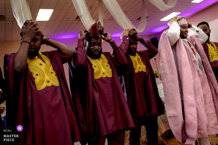 Dolton, IL Wedding Photographer: Groomsmen and Groom wearing their hats in a Traditional Nigerian Wedding