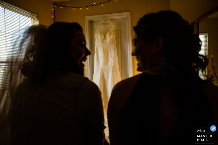 Philadelphia Ballroom Wedding Venue Pictures - Sisters share a moment before she puts on the dress.