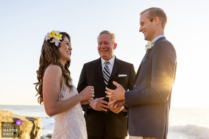 Windansea Beach, San Diego, California wedding image:The bride and groom say, I DO.