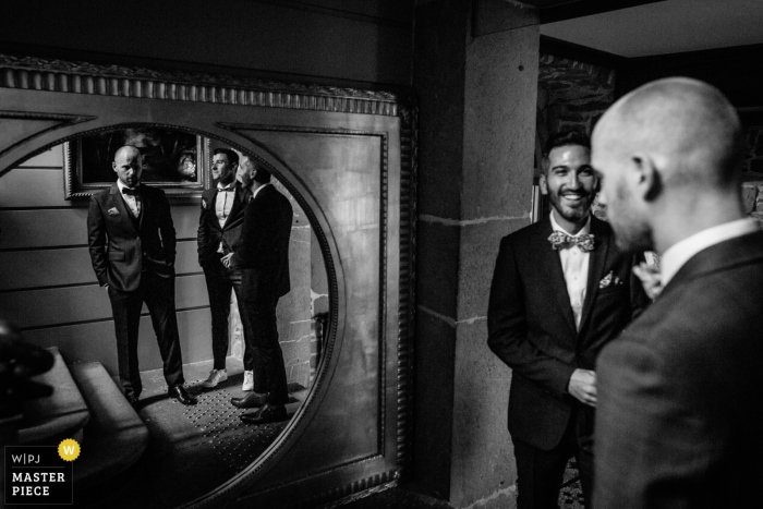 chateau de servolex groom getting ready photography in the mirrors in black and white.