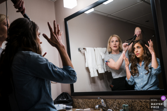 New Jersey Hotel wedding photography of getting ready | Bride describing to her hair stylist what she is looking for