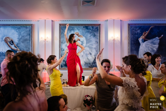 Terra Residence, Sofia wedding image contains: The fourth ballerina dancing in a red dress on the reception tables