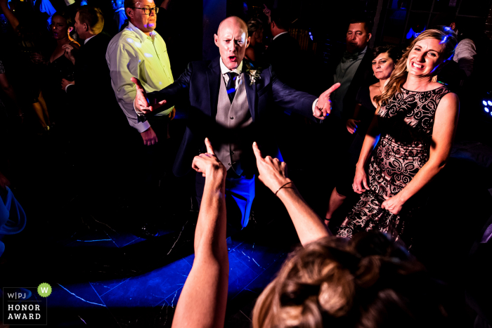 Ironworks (Denver, CO) wedding venue images of the Bride and groom at the reception dance party.