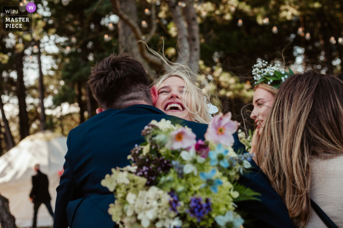 Ravensheugh Log Cabin, Scotland Photographer: Wedding guests congratulate the bride, immediately after the ceremony.