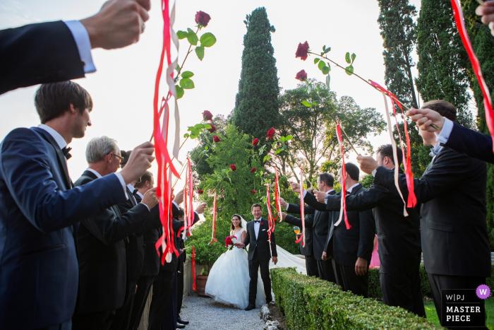 """Isola del Garda wedding photography outdoors: """"The entrance the aperitivo """""""
