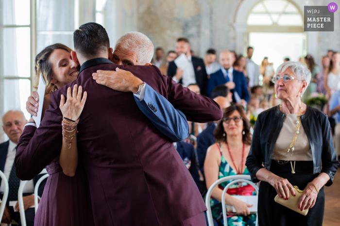 Sagrado - Castelvecchio Family emotions capture in great wedding photos.