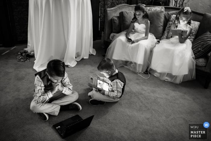 The Villa Parker, Parker, Colorado wedding photography of kids | The ubiquitous screens.