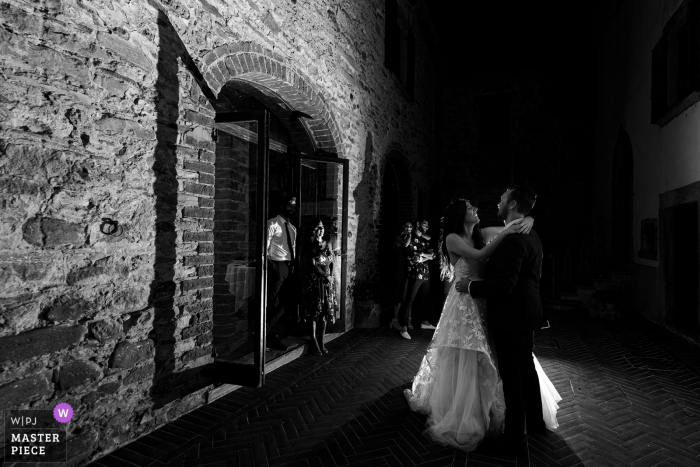 Tuscany wedding reception image in black and white of the first dance in a low light