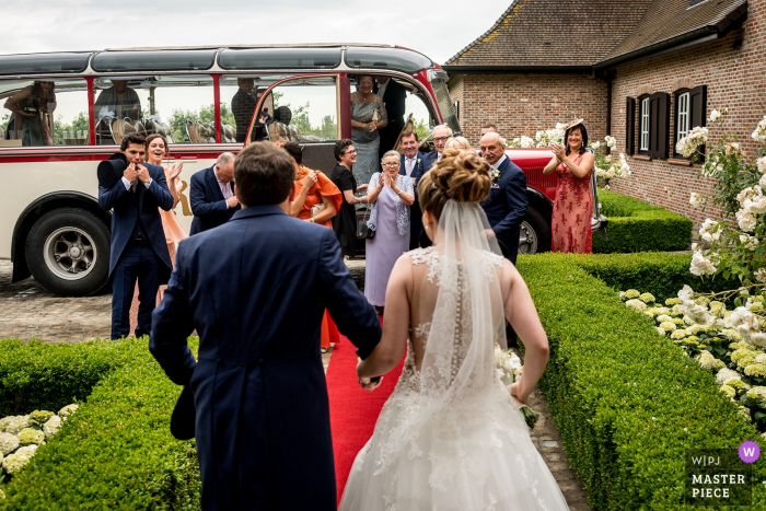 "West Flanders Wedding Photographer: ""The bride and groom walked through the door and they gave the first look to the family. Just love the reactions and happiness on the faces of their family."""