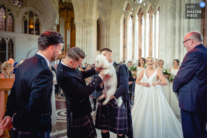 Scotland wedding Ceremony photo of the Best man and groom searching for the rings!